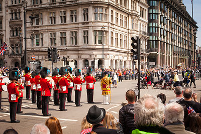 The Band of the Irish Guards play as the Veteran's Parade passes by