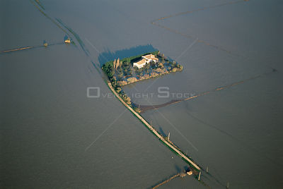 Aerial view of house cut off by flooded River Rhone, Arles Camargue, France, December 2003