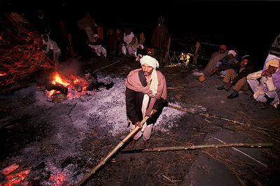 Worker at the Burning Ghat, Varanasi, India