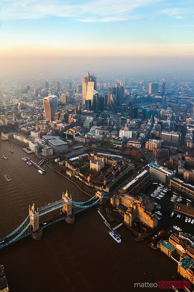 Aerial view of the Tower bridge and the City at sunset, London