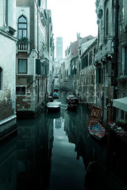 An atmospheric image of a canal in Venice, Italy.