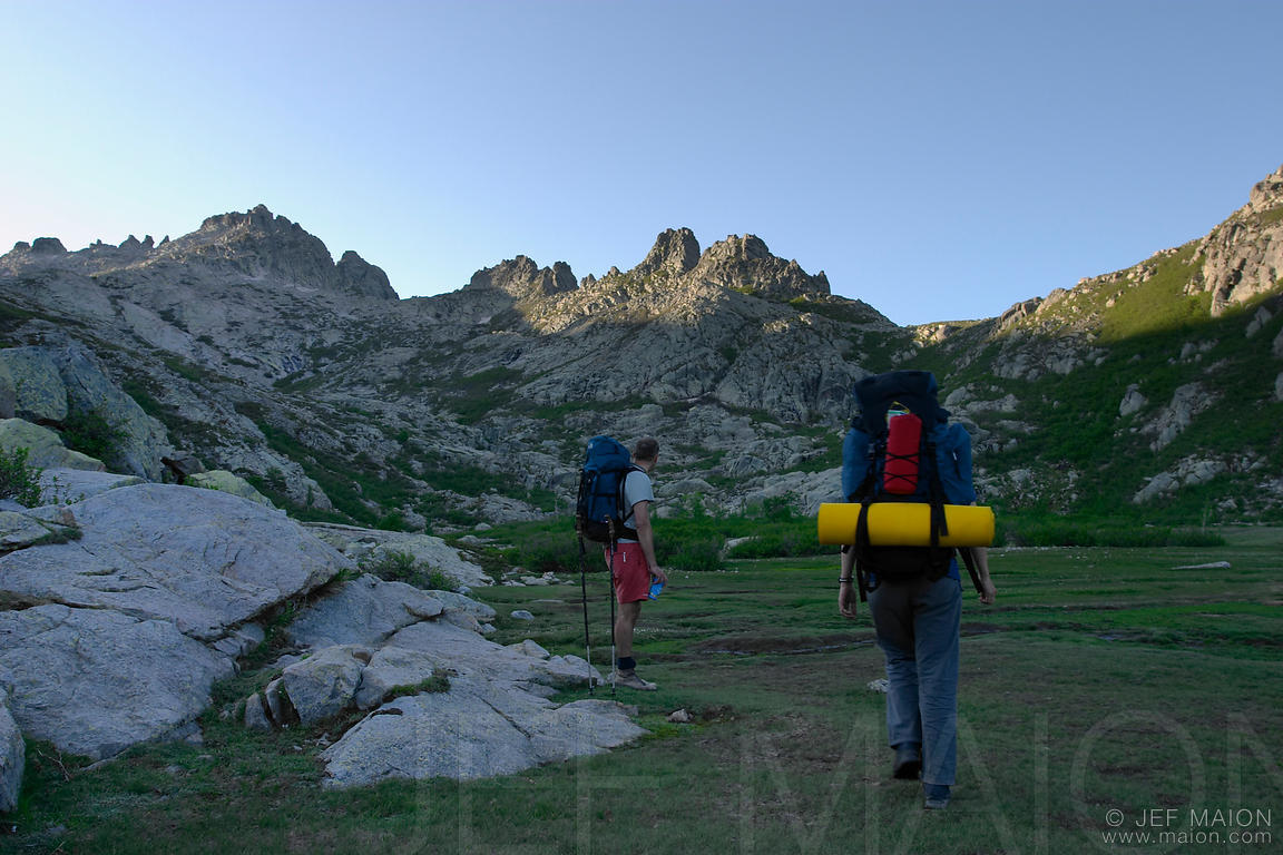 Hikers on mountain meadow