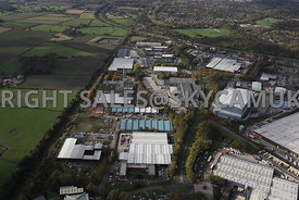 Runcorn high level aerial photograph of Whitehouse Industrial Estate showing the M56 motorway running towards Runcorn in the ...