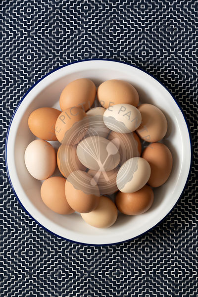 Brown, light brown and white eggs in a bowl.