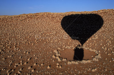 Balloon shadow over Namib Rand NP with 'fairy ring', Namibia