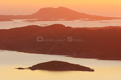 Aerial view of coast with sun low on the horizon, Flatanger, Nord Trøndelag, Norway, August 2008