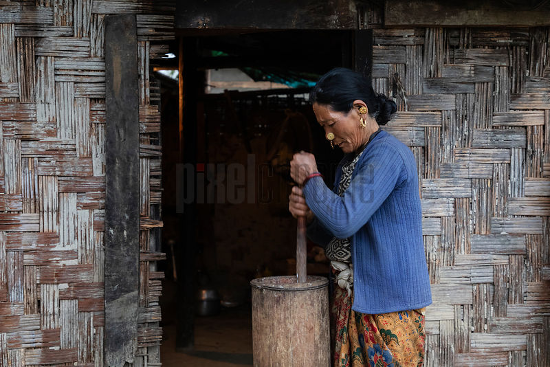 Portrait of Rash Maya Limboo (67) Churning Milk