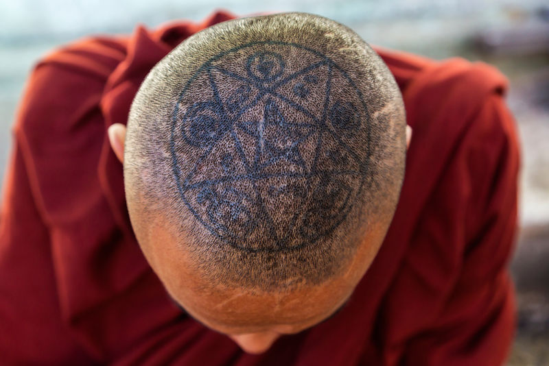 Image of Tattoo on the top of a Monks Head