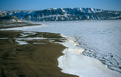Aerial of sea ice near coast Admiralty Inlet, Baffin Island, Canadian High Arctic, June 2000