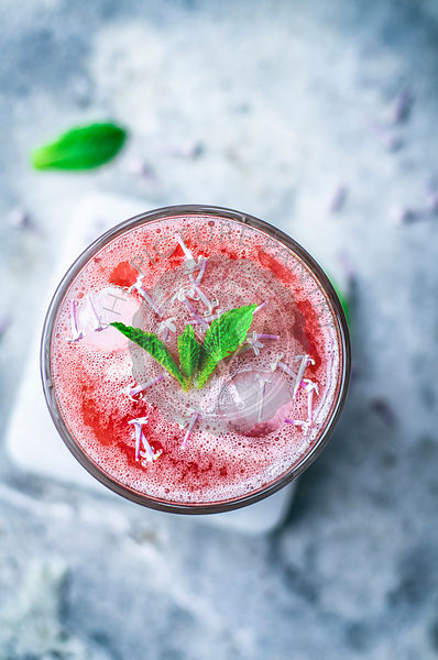 Pink lemonade with mint and lilac blossoms.
