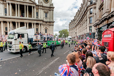 Crowds watch as the Olympic and Paralympic TeamGB athletes parade past St Pauls Cathedral