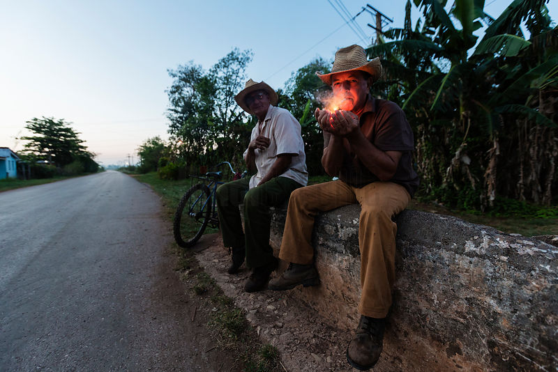 Campesinos Having a Smoke Break on a Bridge Parapet