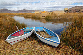 Rowing boats on Uros floating reed islands , Lake Titicaca , Peru