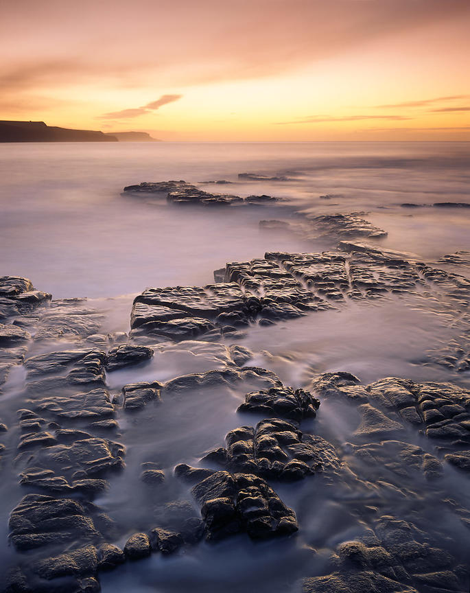 Dawn scene on Dorset Jurassic Heritage Coast. Long exposure makes the water appear misty.