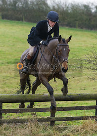 Simon Grieve jumps a hunt jump near Cheseldyne Spinney