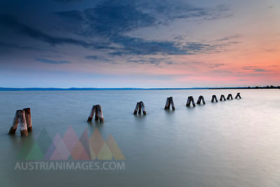Austria, Burgenland, View of piles on Lake Neusiedl at dusk