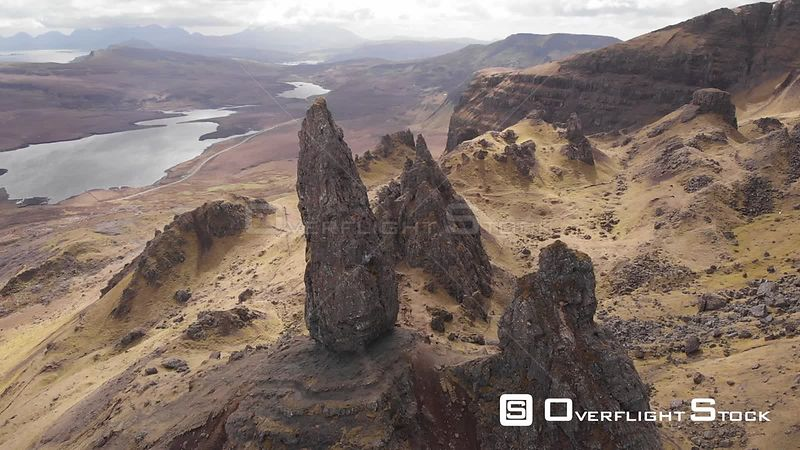 Aerial drone shot circling the Old Man of Storr on a sunny day, Isle of Skye, Scotland
