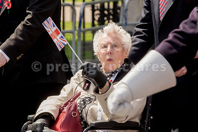 Female Veteran Waving a Flag in the VE Day Veteran's Parade
