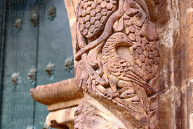 Detail of bird and grape carvings on pillar of main side entrance facade of St John the Baptist of Letrán / San Juan Bautista...
