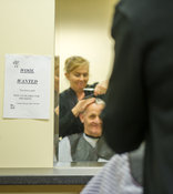 2nd September, 2014. Carnaross Mart, County Meath. Pictured is Brian Connolly Lavey, Cavan getting a haircut from Mary McCabe...