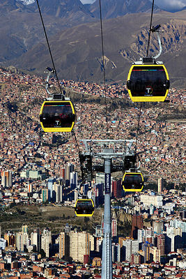 Yellow Line cable car gondolas above Sopocachi in La Paz city centre , Bolivia