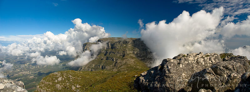 Clouds frame a view of Table Mountain and the Southern suburbs of Cape Town from the sumit of Devil's Peak.