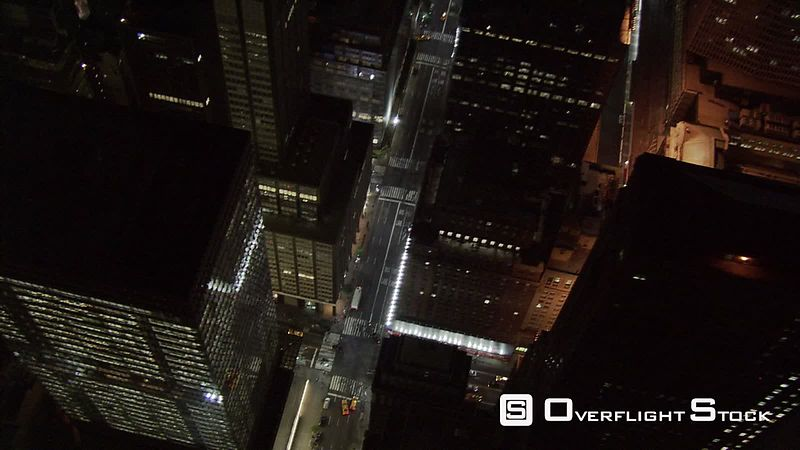 Steep aerial look down into New York City street at night.