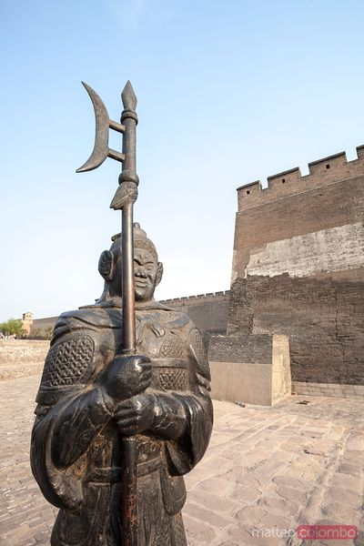 Statue of a chinese warrior near the wall of Pingyao, China
