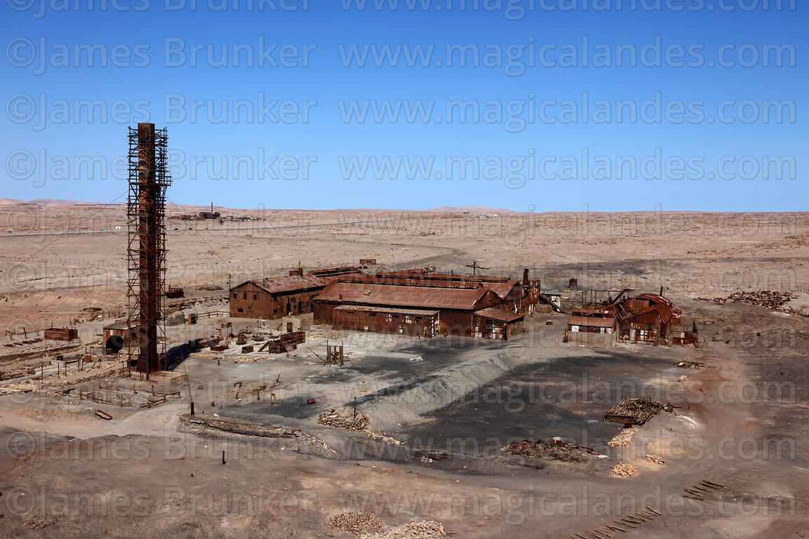 View over processing plant of abandoned nitrate mining town of Humberstone, Region I, Chile