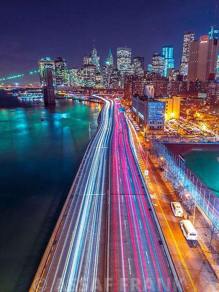 Strip lights on streets of Manhattan by east river, New York