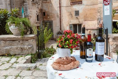 Local wine and bread on display, Sassi di Matera, Italy