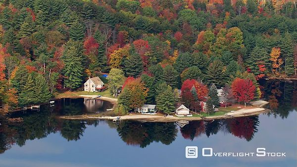 Flying past lakeside homes in New Hampshire