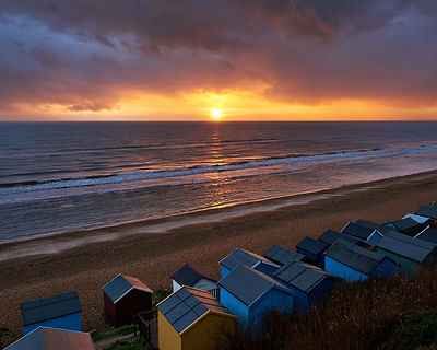 Sunset_over_beach_huts-Milford_on_Sea