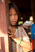 Girl in a stilted village on Tonle Sap Lake near Siem Reap, Cambodia