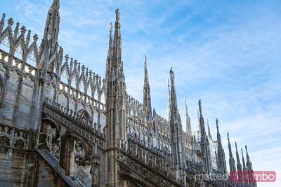 Italy, Lombardy, Milan. Detail of pinnacles of the Duomo