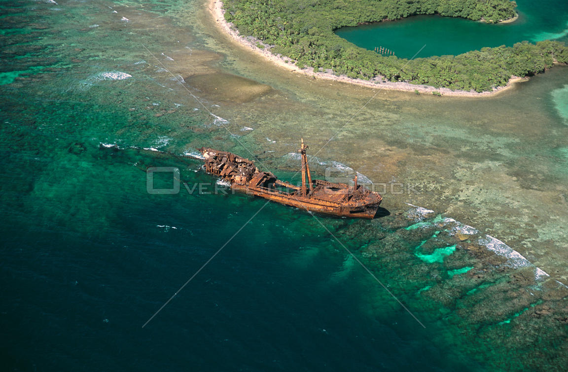 Aerial view of shipwreck on coral reef, Isla de Roatan, Bay Islands, Honduruas, Central America, Atlantic coast 2006