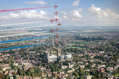 Red Arrows over Lincoln smoke on