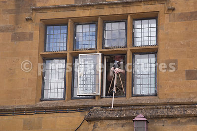 Army Cameraman Filming from an upstairs Window