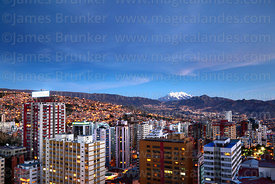 High rise buildings in Sopocachi after sunset, Mt Illimani in distance, La Paz, Bolivia
