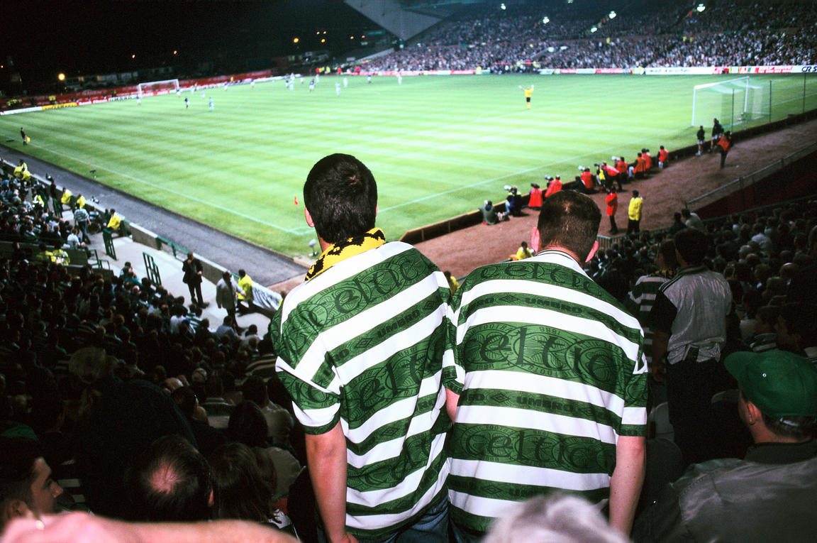 Scotland - Glasgow - Two Celtic fans get out of their seat