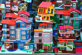 Miniature houses for sale on market stall, Alasitas festival, La Paz, Bolivia