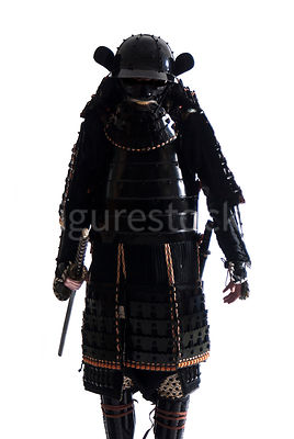 A semi-silouette of a Samurai warrior walking towards camera - shot from eye-level.