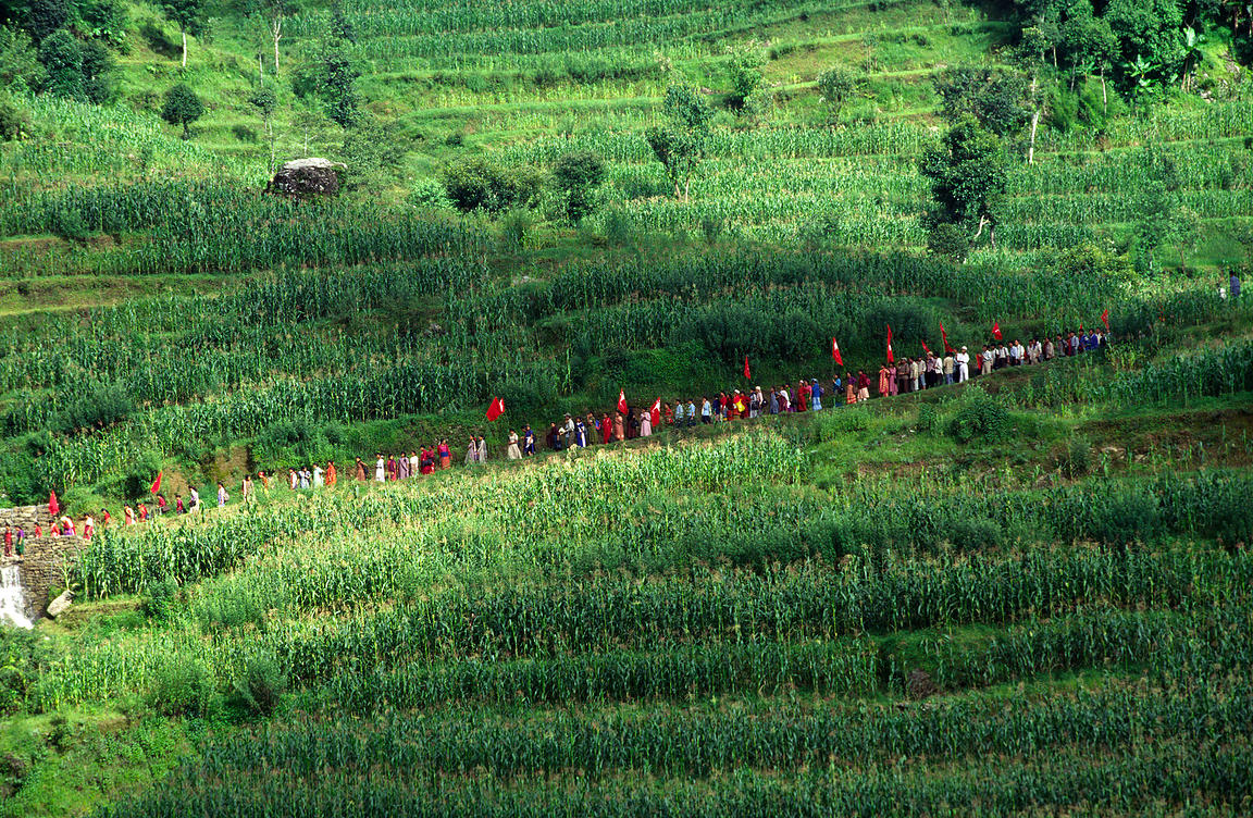 Peasants walk to a Maoist rally in Dolakha, Nepal