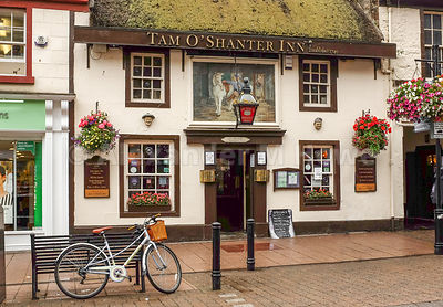 Historic Inn with thatched roof and colourful hanging baskets established in 1749