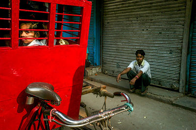 A School Child Sits In An Enclosed Rickshaw