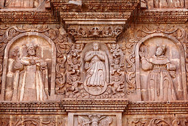 Detail of saints and female figure (Virgin Mary?) surrounded by angels on main facade of cathedral, Puno, Peru