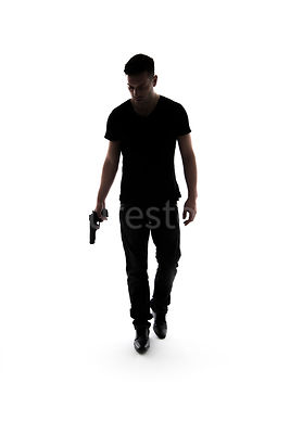 A mystery man, in silhouette, walking towards camera with a gun – shot from eye level.