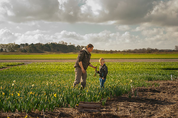 Father and son at work on the flower fields series 7of7