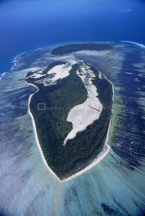 Aerial view of island texture, showing island surrounded by coral reef, Seychelles, Indian Ocean
