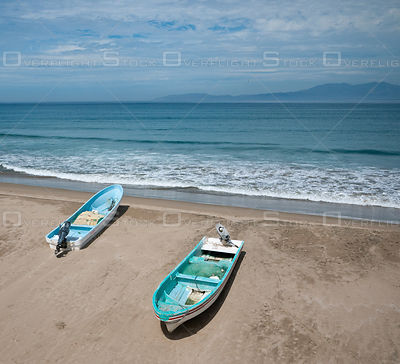 Two fishing boats on the beach at Barra de Potosi, Mexico.